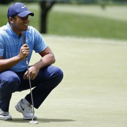 Jhonattan Vegas of Venezuela lines up a putt on the 13th hole during the first round of the Quicken Loans National golf tournament at Bethesda, Maryland. Vegas shot a 65 and trails leader Jon Rahm by one stroke at Congressional Country Club.