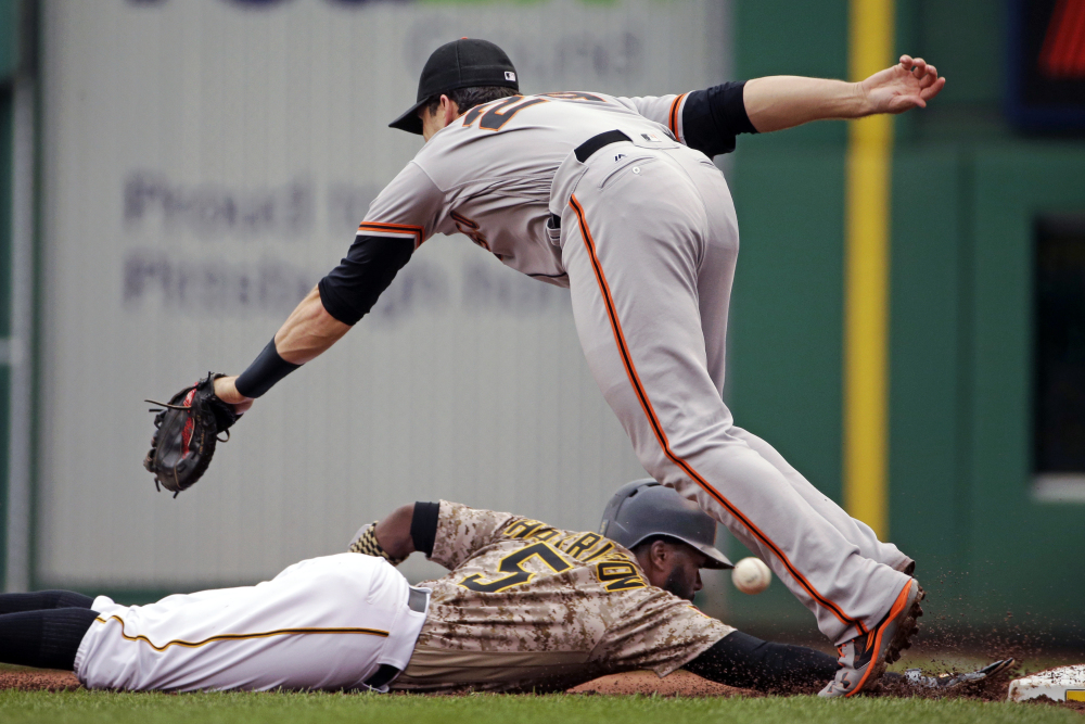 An errant pickoff attempt eludes San Francisco first baseman Buster Posey – a miscue that allowed Pittsburgh's Josh Harrison to reach third during a 5-3 Giants win Thursday at Pittsburgh.