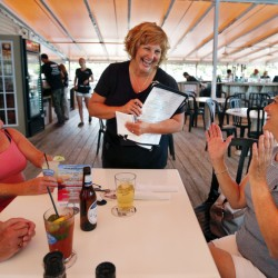 Ann LePage chats with diners after taking their order at McSeagull's restaurant on Thursday in Boothbay Harbor.