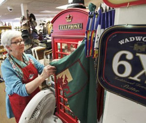 Karen Bussey straightens up at Bridgham & Cook in Freeport. The store imports goods from Britain, but owners say they might not benefit from a lower exchange rate in the long run.