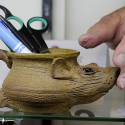 "A pottery mug in the shape of a rat is among items belonging to James ""Whitey"" Bulger and Catherine Greig that will go on the auction block Saturday."