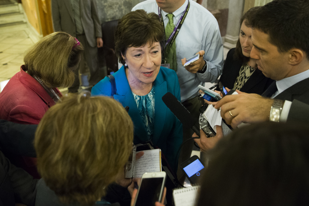 Sen. Susan Collins, R-Maine, center, led a bipartisan effort to craft a Senate gun-control bill that would make it possible to deny firearms to people on two FBI lists.