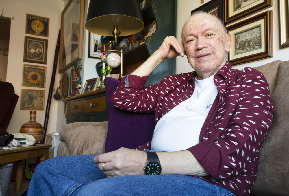 "Michel Cadorette, 79, sits in his Portland apartment on Friday. He says he will vote for Democrat Hillary Clinton, but somewhat reluctantly. ""There are issues with her that are a bit of a turn-off but I guess it's what they call the lesser of two evils at this point,"" he said."