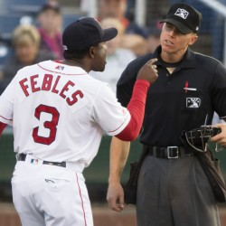 Portland Sea Dogs Manager Carlos Febles argues with plate umpire Chris Graham after being ejected for disputing balls and strikes Friday night during the third inning of an 11-3 loss to Reading at Hadlock Field. It was Febles' second ejection this year.