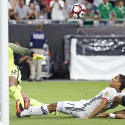 Colombia's Carlos Bacca sends the ball past U.S. goalkeeper Tim Howard for the only goal Saturday night in the Copa America third-place game in Glendale, Ariz.
