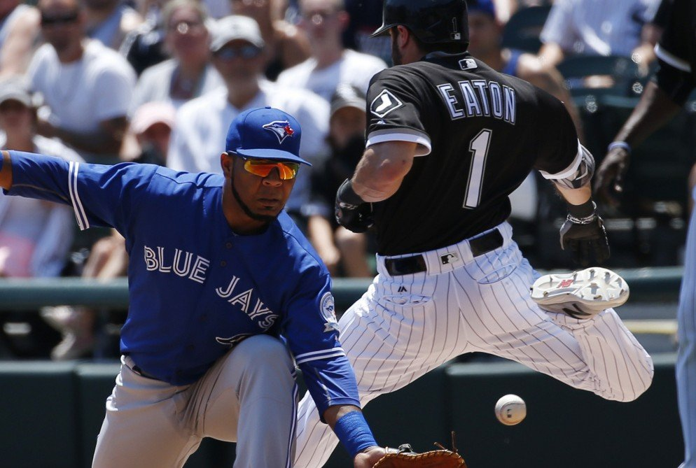Adam Eaton of the White Sox is safe with a single as Blue Jays first baseman Edwin Encarnacion reaches for the late throw during Toronto's 10-8 win Saturday.