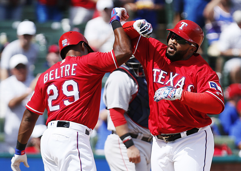 Prince Fielder, right, celebrates with Adrian Beltre after hitting a two-run homer for the Texas Rangers in a 6-2 win Sunday over the Red Sox in Arlington, Texas.