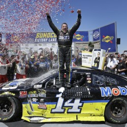 Tony Stewart celebrates after he snapped an 84-race winless drought with a road course victory Sunday in Sonoma, California.