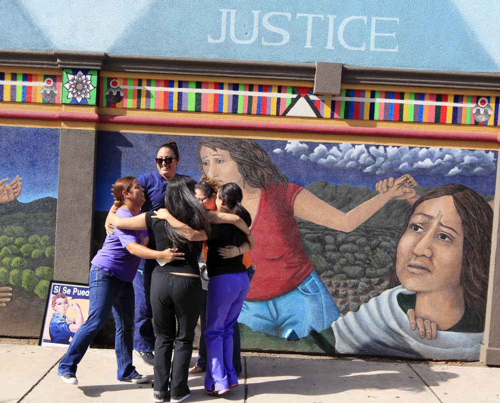 Staff members of Whole Woman's Health celebrate in front of a mural on the side of the building in McAllen, Texas, after the Supreme Court ruling against Texas' abortion restrictions Monday. Whole Woman's Health is an abortion provider that stayed open.