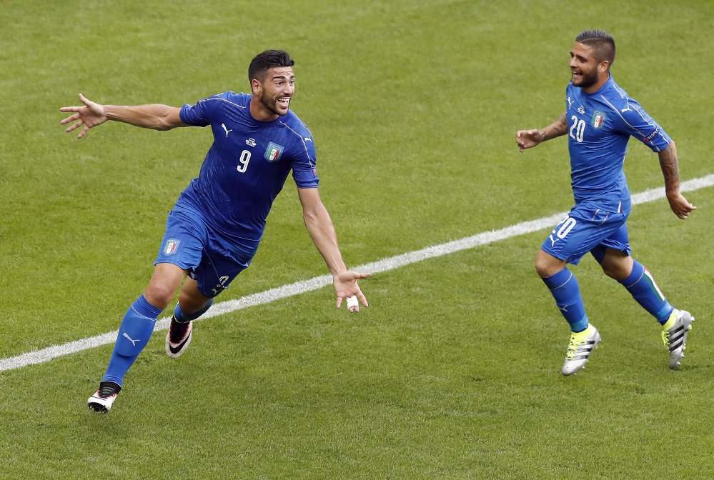 Graziano Pelle, left, celebrates with Lorenzo Insigne after scoring the clinching goal in Italy's 2-0 win over Spain in Saint-Denis, France.