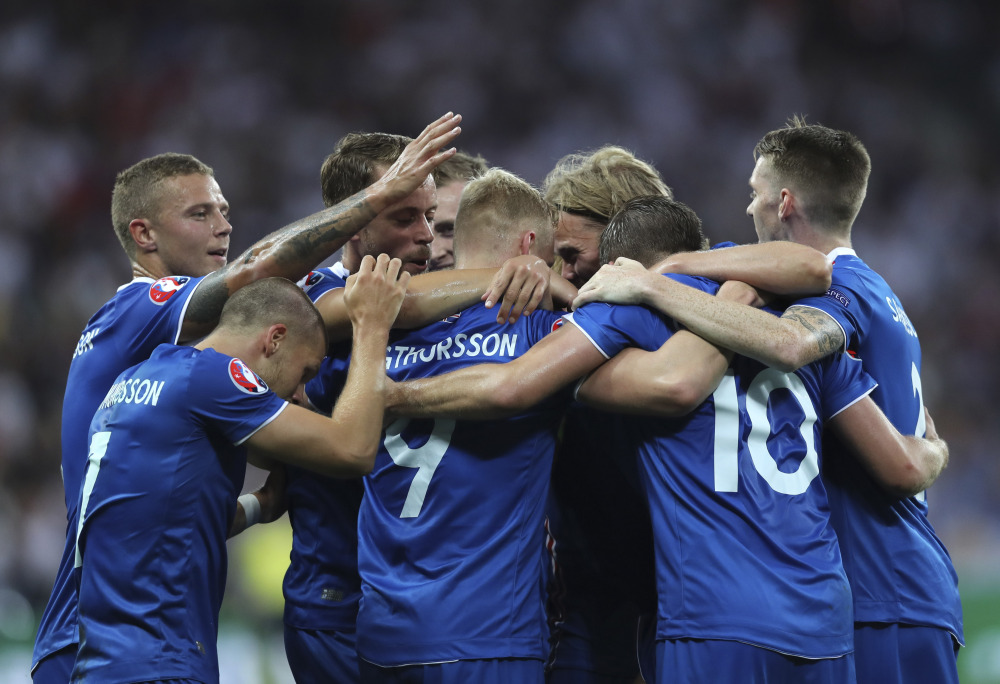 Iceland players celebrate after Kolbeinn Sigthorsson, center, scored the go-ahead goal Monday in a 2-1 victory over England at the European Championships in Nice, France.