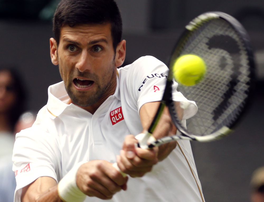 Novak Djokovic opened defense of his Wimbledon title with a 6-0, 7-6 (3), 6-4 victory Monday over James Ward.