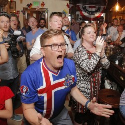 Petur Petersen, center, and others react at Ri Ra, a Portland pub, during Iceland's victory Monday over England. They'll be cheering again Sunday in the quarterfinals against France.
