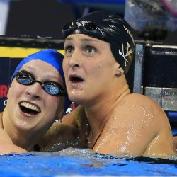 Katie Ledecky, left, reacts with Leah Smith after winning the 400-meter freestyle final Monday night at the U.S. Olympic swimming trials. Smith was second and will be on the team.
