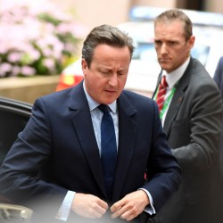 British Prime Minister David Cameron, left, arrives for an EU summit in Brussels. EU heads of state and government meet Tuesday and Wednesday in Brussels for the first time since Britain voted to leave the European Union, throwing British and European politics into disarray.