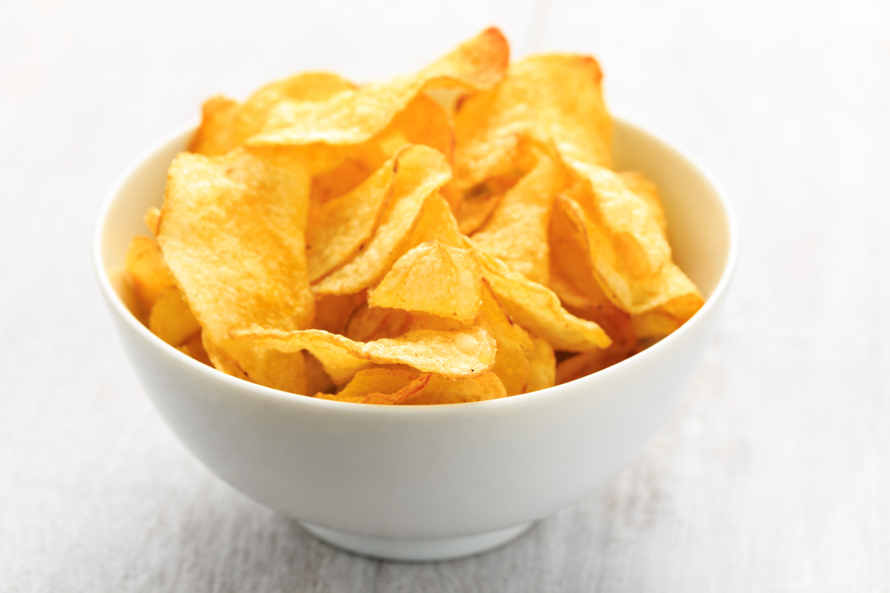 Potato chips don't have much redeeming nutritional value and the added salt in your diet can cause problems.