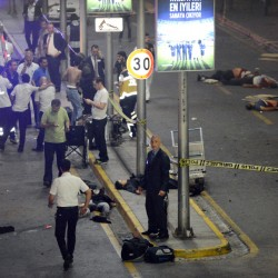Medics and security personnel work at the entrance of the Ataturk airport in Istanbul after two explosions rocked the airport. A Turkish official said attackers blew themselves up at the airport after police fired at them.