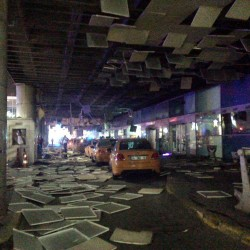 An entrance of the Ataturk Airport in Istanbul is littered after explosions Tuesday that killed at least 10 people and wounded around 20 others.