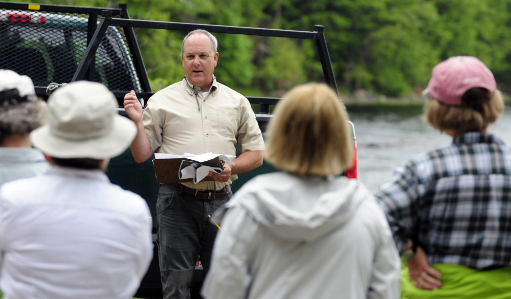 Department of Inland Fisheries and Wildlife biologist G. Keel Kemper talks to people before a tour of Jamies Pond Wildlife Management Area in Hallowell on Tuesday.