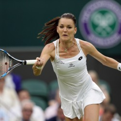 Agnieszka Radwanska of Poland returns to Kateryna Kozlova of the Ukraine during their women's singles match on day three of the Wimbledon Tennis Championships in London Wednesday.