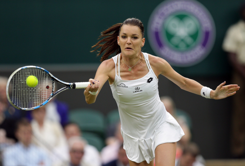 Agnieszka Radwanska returns to Kateryna Kozlova during their women's singles match on day three of Wimbledon in London Wednesday.