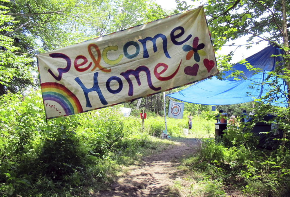 A sign welcomes people to the gathering of the Rainbow Family of Living Light in Mount Tabor, Vt. The decades-old get-together is held each year on national forestland.