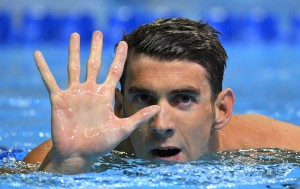 Michael Phelps gestures after winning the men's 200-meter butterfly at the U.S. Olympic swimming trials on Wednesday in Omaha, Neb. to secure his spot on a fifth Olympic team.