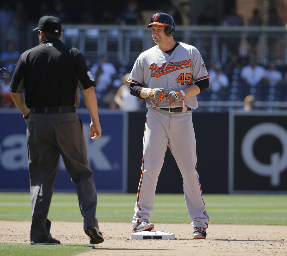 Baltimore Orioles' Mark Trumbo stands on second base after hitting a double during the ninth inning of Wednesday's 12-6 victory at San Diego.