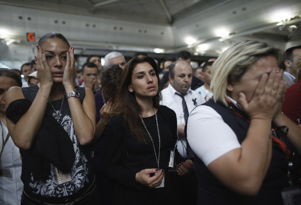 Family members, colleagues and friends of the victims of Tuesday's blasts gather for a memorial ceremony at the Ataturk Airport in Istanbul, on Thursday.