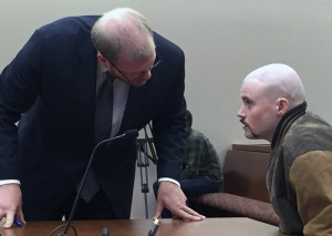 Attorney Scott Hess confers with his client, Leroy Smith III, during a hearing. The defense maintains Smith is not competent to enter a plea or stand trial on the charge of killing his father.