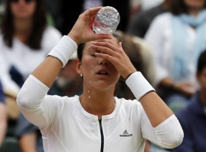 Garbine Muguruza of Spain cools down Thursday during a break in her Wimbledon singles match against Jana Cepelova of Slovakia. A total of 18 seeded players, including Muguruza, lost on Day 4 of the tournament.