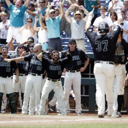 Coastal Carolina's G.K. Young, 37, and the dugout celebrate as Young touches home plate after hitting a two-run home run against Arizona in the sixth inning in Game 3 of the College World Series in Omaha, Neb. on Thursday afternoon.