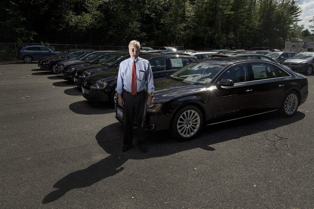 "Bill Sowles, owner of Morong Falmouth, has 45 diesel vehicles that he's barred from selling. The owners of 3,630 cars in Maine caught up in Volkswagen's  emissions software scandal will receive payments of at least $5,100 and other perks, but dealer compensation has yet to be worked out. ""We're waiting to hear what they will do for us,"" Sowles said."