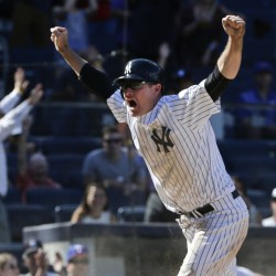 Chase Headley of the New York Yankees celebrates after scoring the winning run on a passed ball in the ninth inning of a 2-1 victory over the Rangers at New York on Thursday.