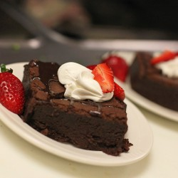 Fudge brownies topped with fresh strawberries and whipped cream at Mercy Hospital.