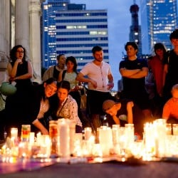 People gather for a vigil in memory of the victims of the Orlando, Fla., mass shooting, Monday at City Hall in Philadelphia.