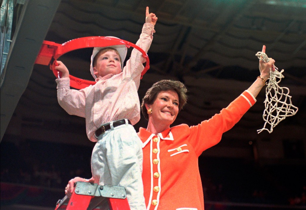 Pat Summitt and son Tyler take down the net after Tennessee defeated Georgia 83-65 in the title game at the 1996 NCAA women's basketball Final Four at Charlotte Coliseum.