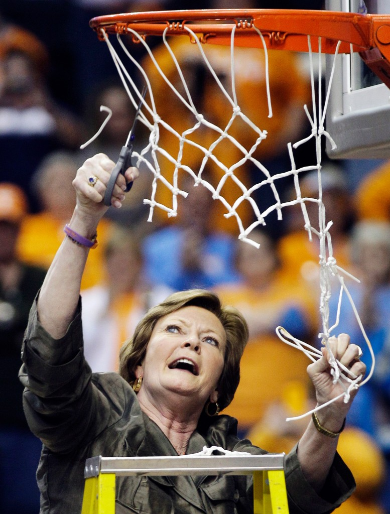 Summitt cuts down the net after Tennessee defeated LSU to win the 2012 Southeastern Conference women's basketball tournament in Nashville.