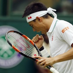 Kei Nishikori of Japan celebrates a point against Julien Benneteau of France during their men's singles match on day four of the Wimbledon.
