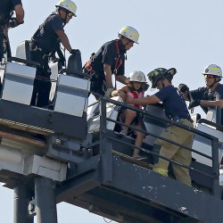 Oklahoma City firefighters rescue a child from a stalled roller coaster in Oklahoma City.
