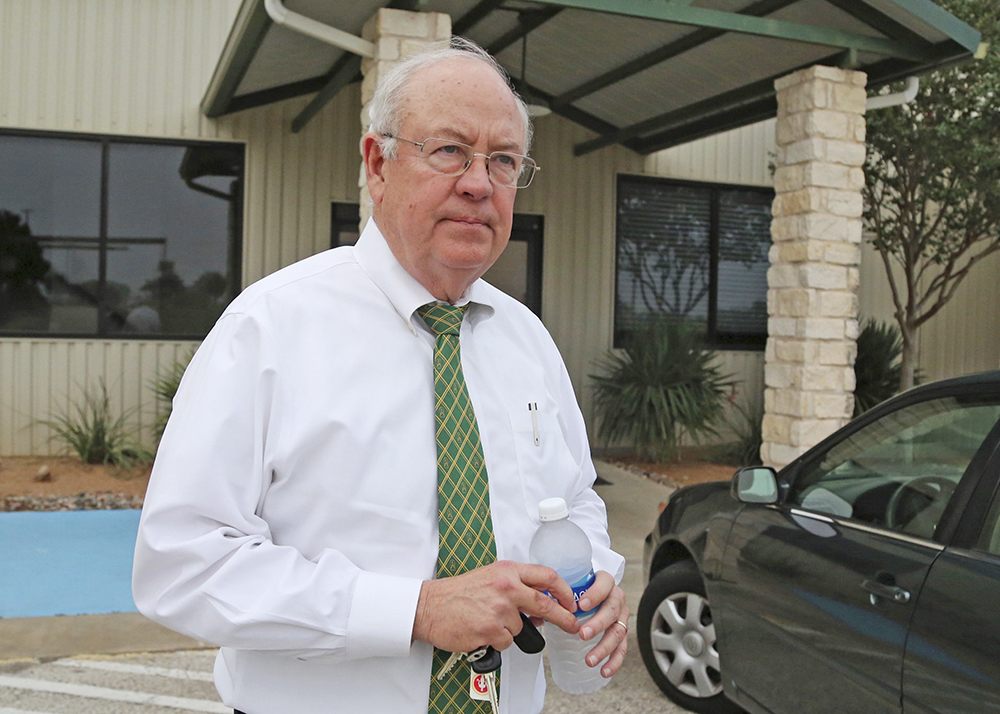 "Then-Baylor University President Ken Starr leaves the Waco, Texas, airport in this May, 25, 2016, photo. Starr told ESPN Wednesday that he resigned the chancellor position ""with sorrow"" and ""as a matter of conscience."" Rod Aydelotte/Waco Tribune Herald, via AP"