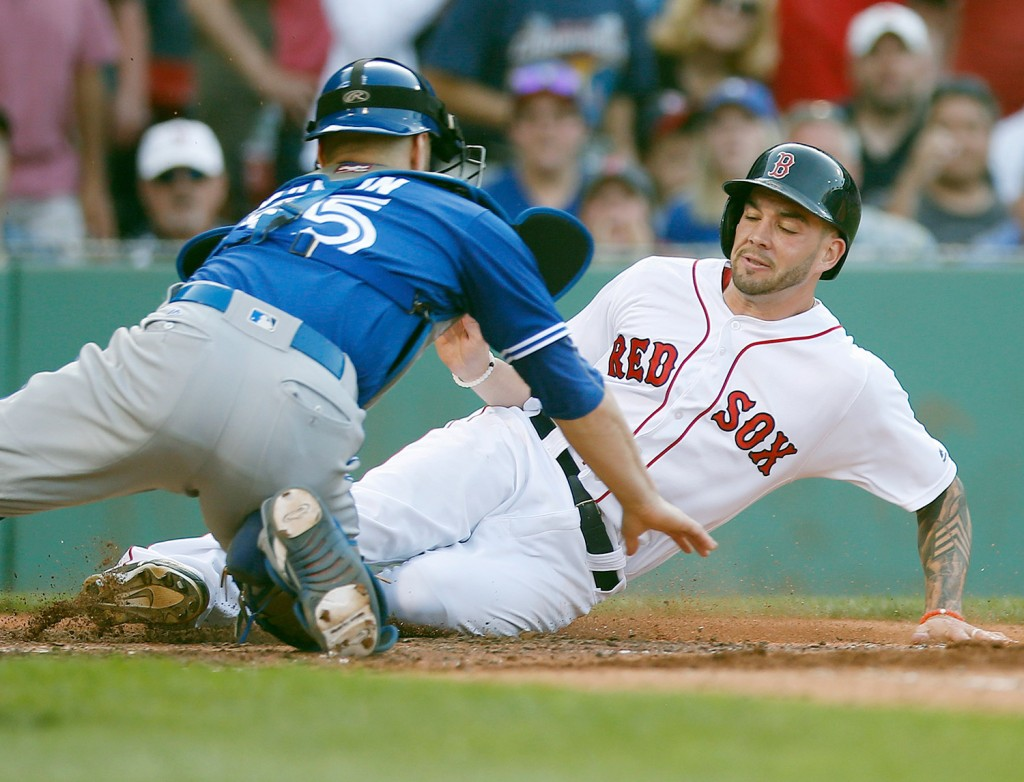 Blake Swihart, seen scoring in a game in Boston in June, started last season as the starting catcher for the Red Sox. From there, we went to Pawtucket, to left field and to the disabled list. Now, he's back as a catcher.