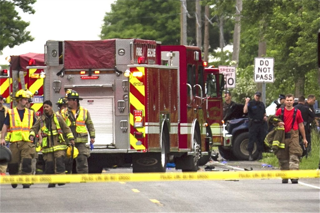 Police and rescue workers attend to the scene after multiple bicyclists were struck by a vehicle in a deadly crash Tuesday evening in Cooper Township, Mich. Chelsea Purgahn/Kalamazoo Gazette-MLive Media Group via AP