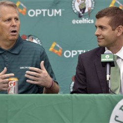 FILE - In this July 5, 2013, file photo, Boston Celtics general manager Danny Ainge, left, speaks alongside new head coach Brad Stevens, right, during an NBA basketball news conference in Waltham, Mass. Theoston Celtics have extended the contracts of  Stevens and Ainge, the team announced Wednesday, June 1, 2016.(AP Photo/Josh Reynolds)