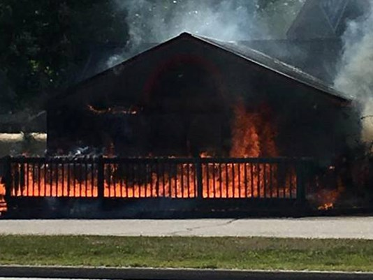 Fire started on a porch at Domino's Pizza in Windham on Monday afternoon.