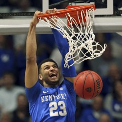 FILE - In this March 13, 2016, file photo, Kentucky's Jamal Murray (23) dunks over Texas A&M's Danuel House, bottom, during the first half of an NCAA college basketball game in the championship of the Southeastern Conference tournament in Nashville, Tenn. Murray, from Canada, could go quickly in the NBA Draft on Thursday night, June 23, 2016, in New York. (AP Photo/John Bazemore, File)
