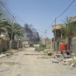 Smoke rises from a neighborhood in central Fallujah as Iraqi counterterrorism forces battle Islamic State militants in the southern part of the city on Tuesday. The elite troops repelled a four-hour attack by the Islamic State group. The Associated Press