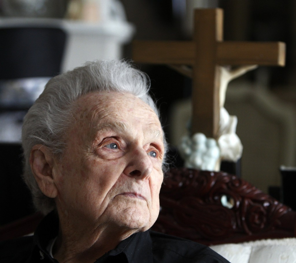 Ralph Stanley looks out a window of his home outside of Coeburn, Va., in  January 2012. He won a Grammy for best male country vocal performance in 2002 — beating out Tim McGraw, Ryan Adams, Willie Nelson, Johnny Cash and Lyle Lovett. Bob Brown/Richmond Times-Dispatch via AP