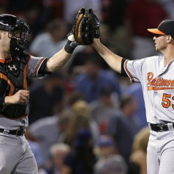 Baltimore closer Zach Britton is congratulated by catcher Matt Wieters after closing out the Orioles' 3-2 win over Boston on Tuesday.   Associated Press/Charles Krupa