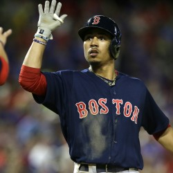 Mookie Betts celebrates his home run during the ninth inning against the Rangers in Arlington, Texas, on Friday. The Red Sox won 8-7.  AP Photo/LM Otero